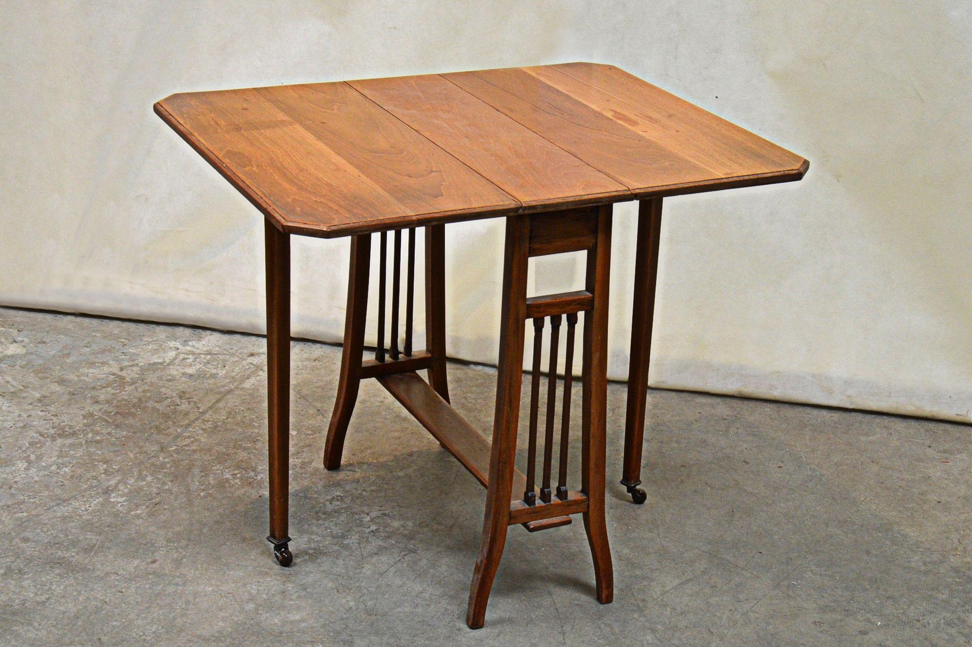 288 An antique light oak Sutherland table
