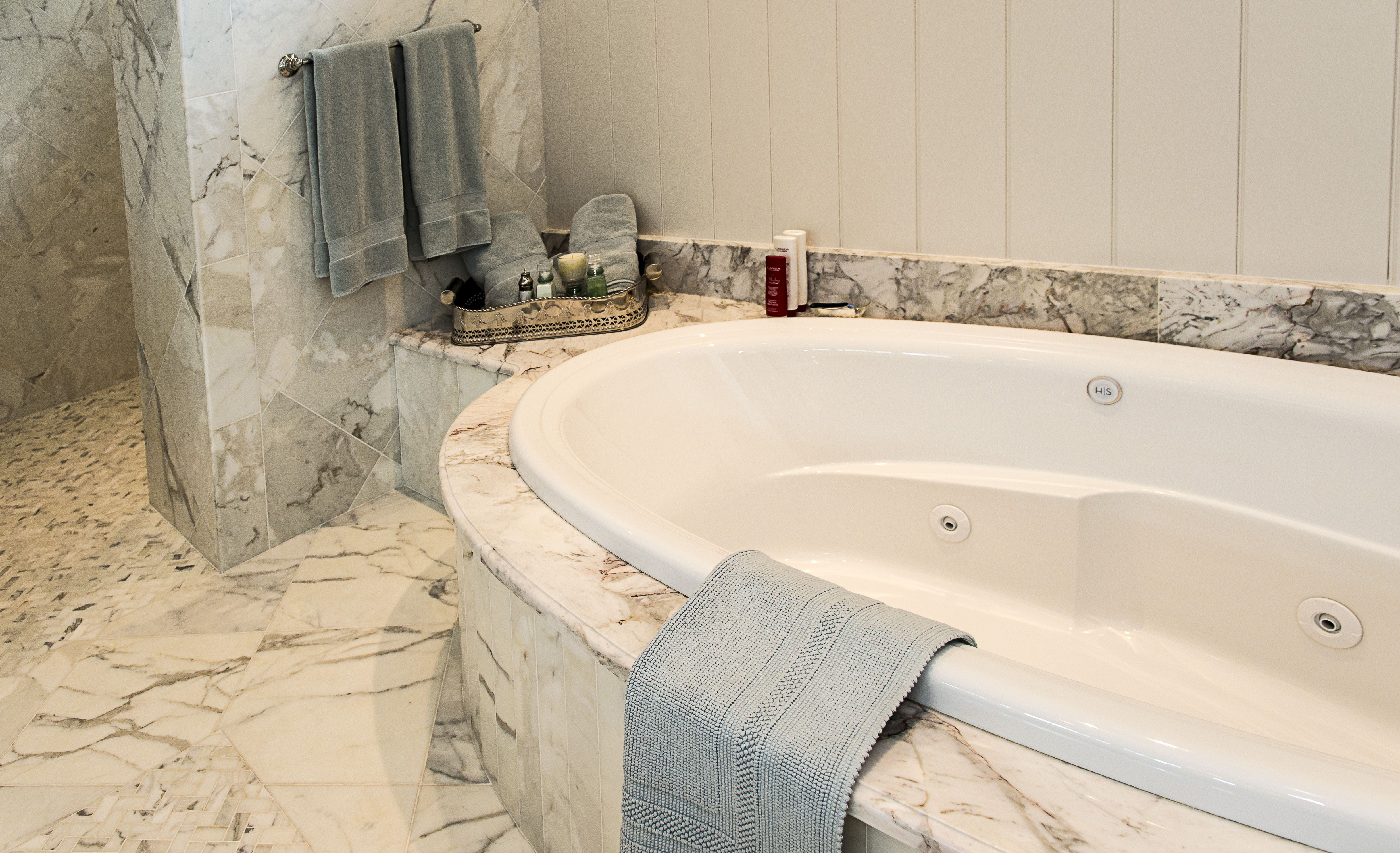 Ah, to sink into this jet tub, with the beautiful Calacatta Gold ...