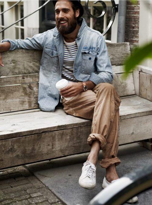 Shop this look on Lookastic:  https://lookastic.com/men/looks/denim-jacket-long-sleeve-t-shirt-chinos-low-top-sneakers-hat-watch/11891  — Black Wool Hat  — White and Black Horizontal Striped Long Sleeve T-Shirt  — Grey Denim Jacket  — Beige Watch  — Khaki Chinos  — White Low Top Sneakers
