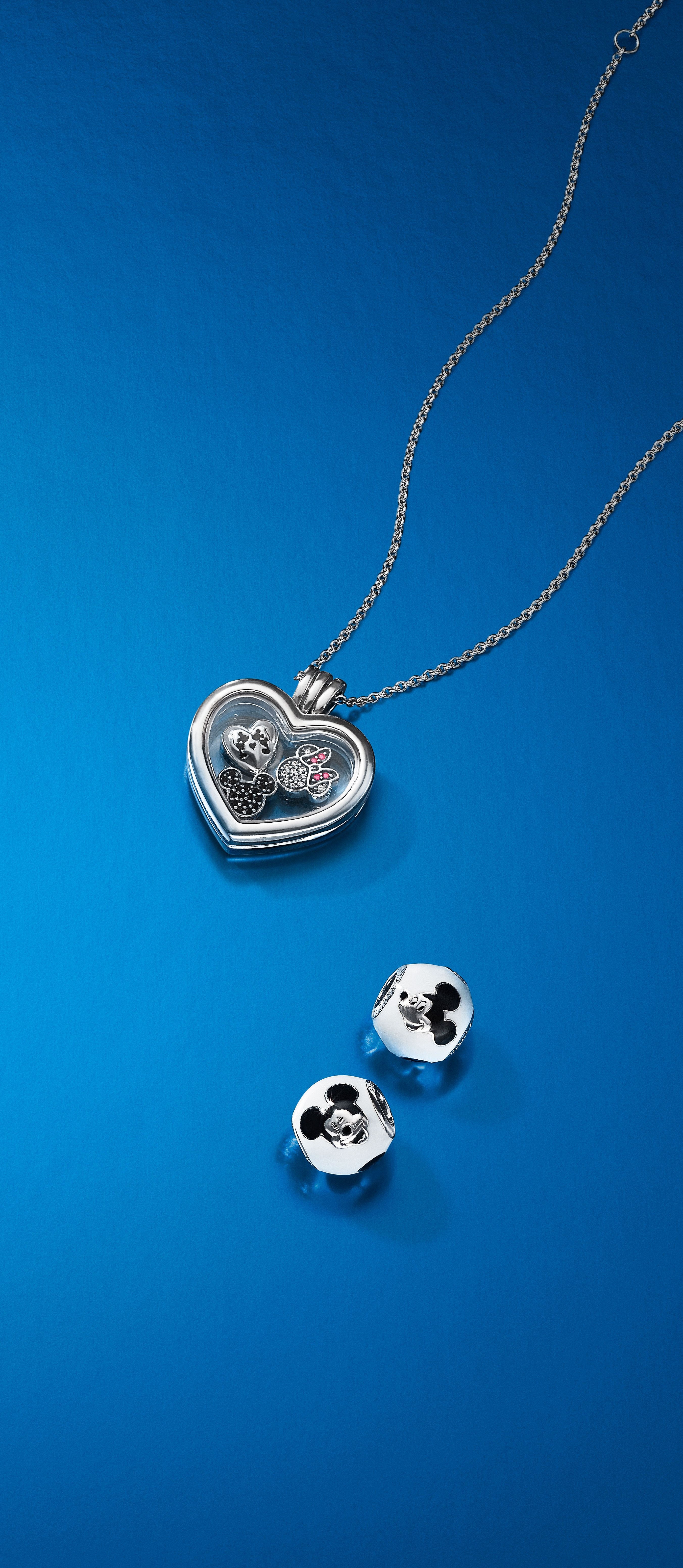 20bba1749 Put a magical spin on your floating locket with new Mickey and Minnie Mouse  petites, or tell your story with intricately crafted charms.