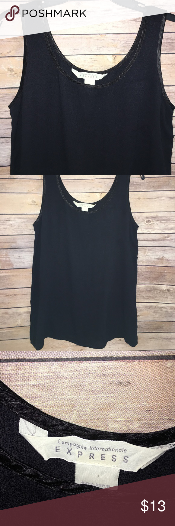 Express sleeveless navy blouse Navy blue sleeveless top. Has side slots and silky trim. Express Tops Blouses