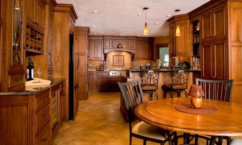 Attractive Mullet Cabinet   French Country Kitchen Featuring Warm Cherry Wood Tones.