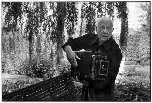 Photographer Paul Strand in the garden of his house, Orgeval, France, 1972 by Martine Franck