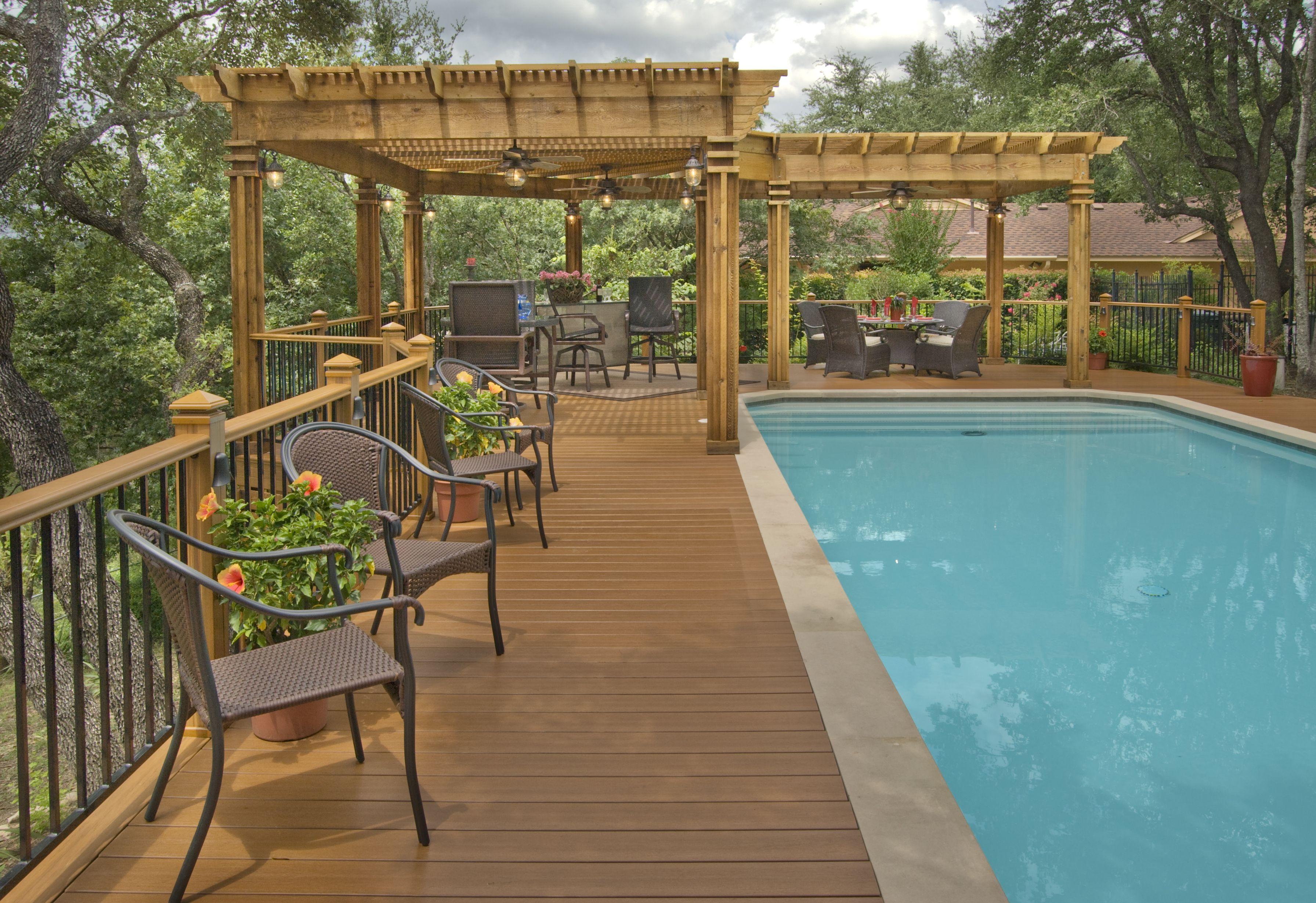 Low maintenance pool deck with cedar pergola landscaping for L shaped pergola
