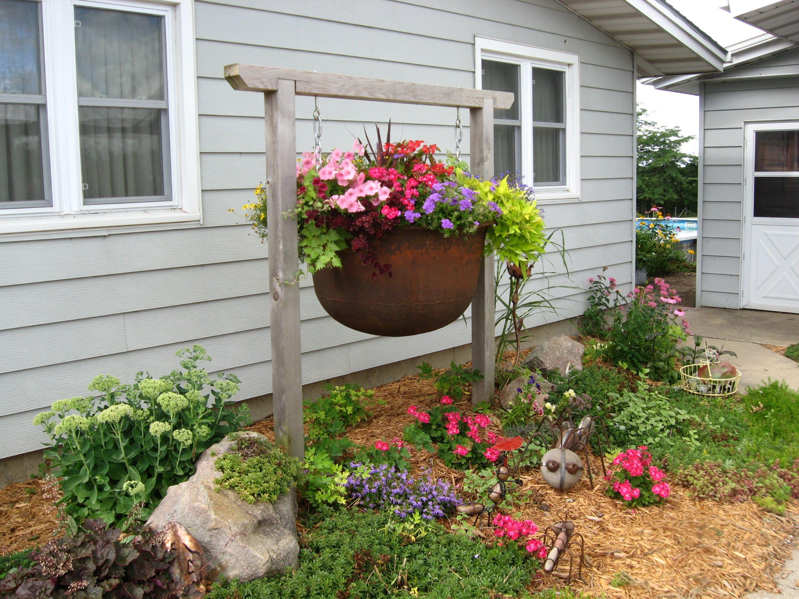 Garden Hanging Cauldron Filled With Flowers Garden Art