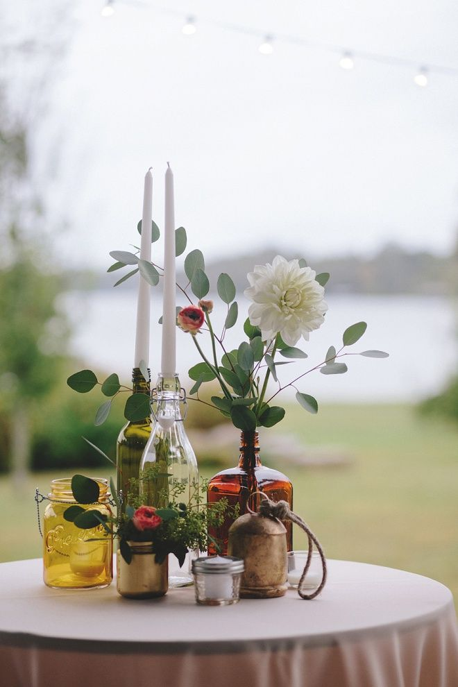Mismatched hand painted bottles and flowers for