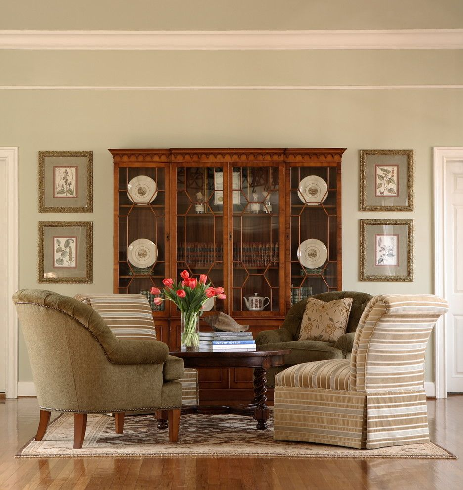 China Cabinet In Living Room - love the framed photos on either side ...