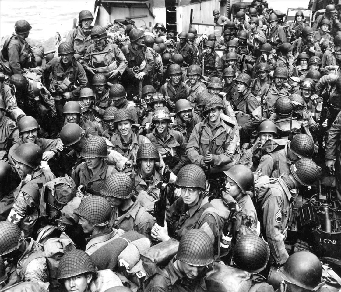 Ready boys? US troops fill an amphibious assault craft en route to landing on the Normandy shores, June 6, 1944. Mostly smiling faces. Many of these men had just hours to live.