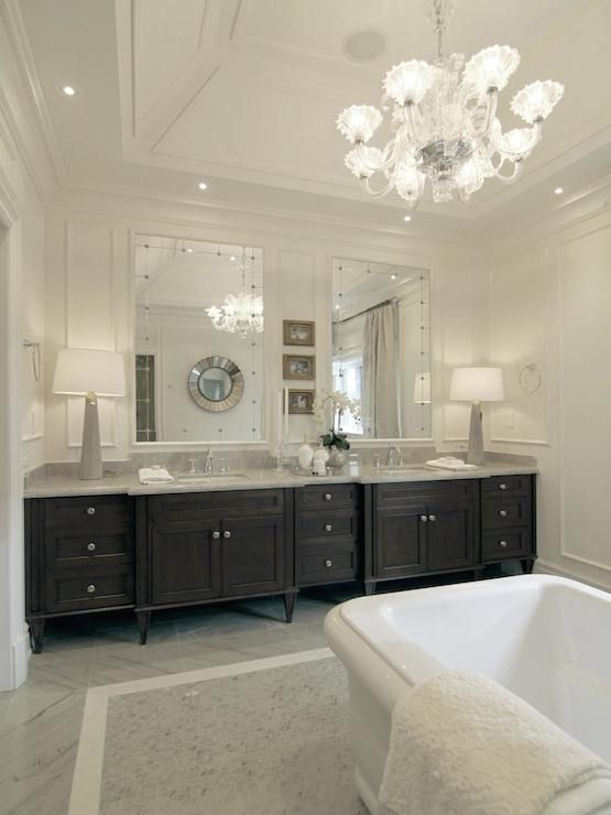 Tradition bathroom features tray ceiling accented with glass