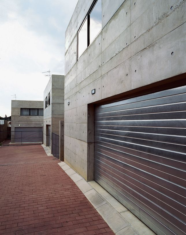 Love this galv. metal garage door.  Project: Katz Residence  Architects: Gregory Katz  Location: Norwood, South Africa