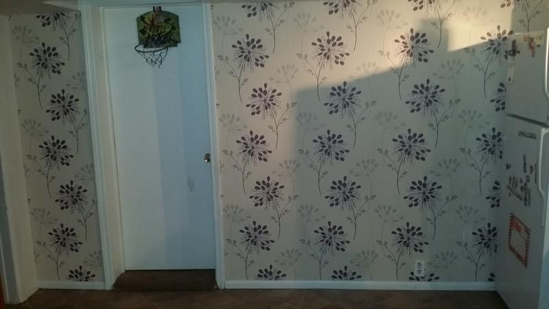 The delicate floral pattern of our Burst wallpaper has given this customer's kitchen a beautiful feature wall