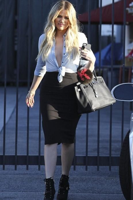 Khloe Kardashian wearing Hermes 35cm Birkin Bag in Black and Fendi Karlito Fox Fur Two Tone Bag Charm