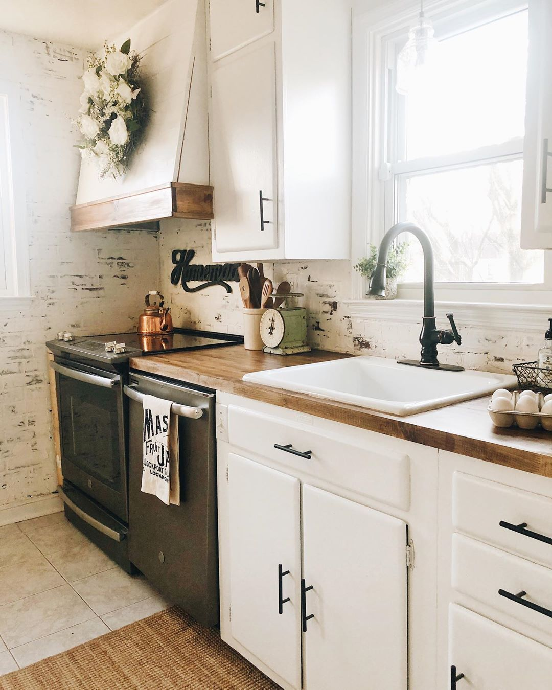 Farmhouse kitchen with wood countertops and faux brick