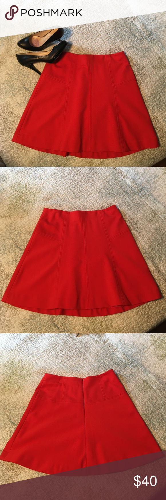 Beautiful red skirt Red skirt from The Loft. The shell is 67% rayon, 28% nylon, 5% spandex. The lining is 100% polyester. Very comfortable. Goes great with boots for the fall or sandals for the summer. Able to dress for work or a night out, very versatile. LOFT Skirts A-Line or Full