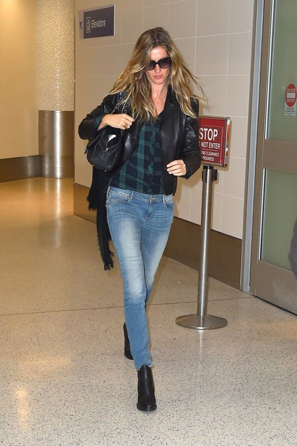 Gisele Bundchen wears a blue and green tartan plaid Rails shirt with a leather jacket, jeans, and ankle boots
