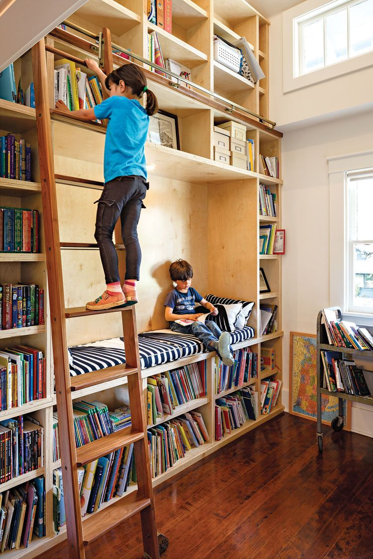 Modern doubleheight library room renovation with rolling ladder