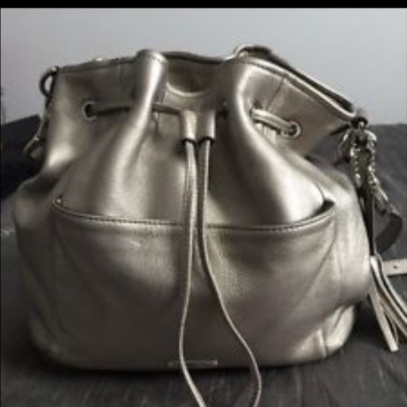 53a3639591d0 Silver Coach draw string purse Authentic Coach soft leather, silver  drawstring purse in new condition! This is a great bag that goes with any  outfit.