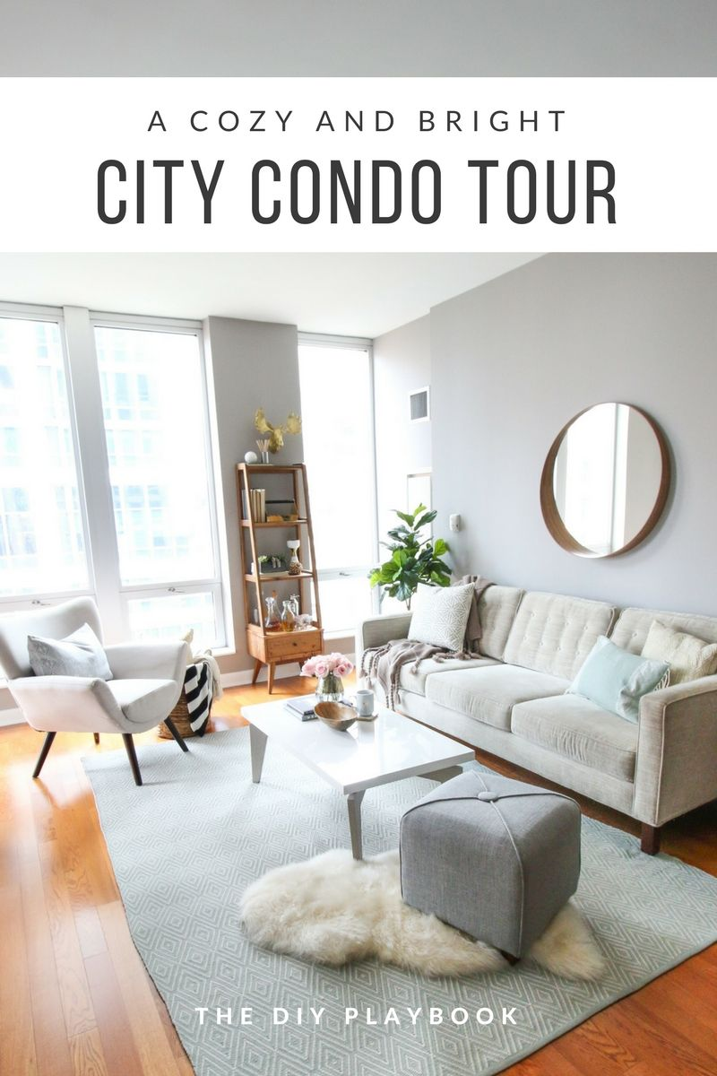 A Feminine Chicago Condo Tour With Glam Accents The Diy Playbook Condo Living Room Chic Living Room Decor Small Living Room Decor