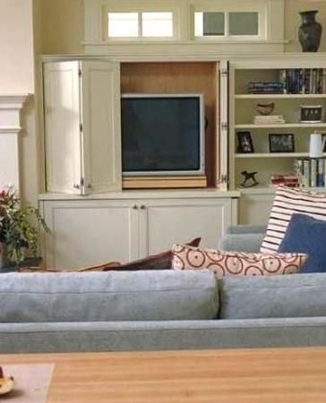 22 Modern Ideas To Hide Tvs Behind Hinged Or Sliding Doors Built In Tv Cabinet Fireplace Built Ins Contemporary Family Rooms