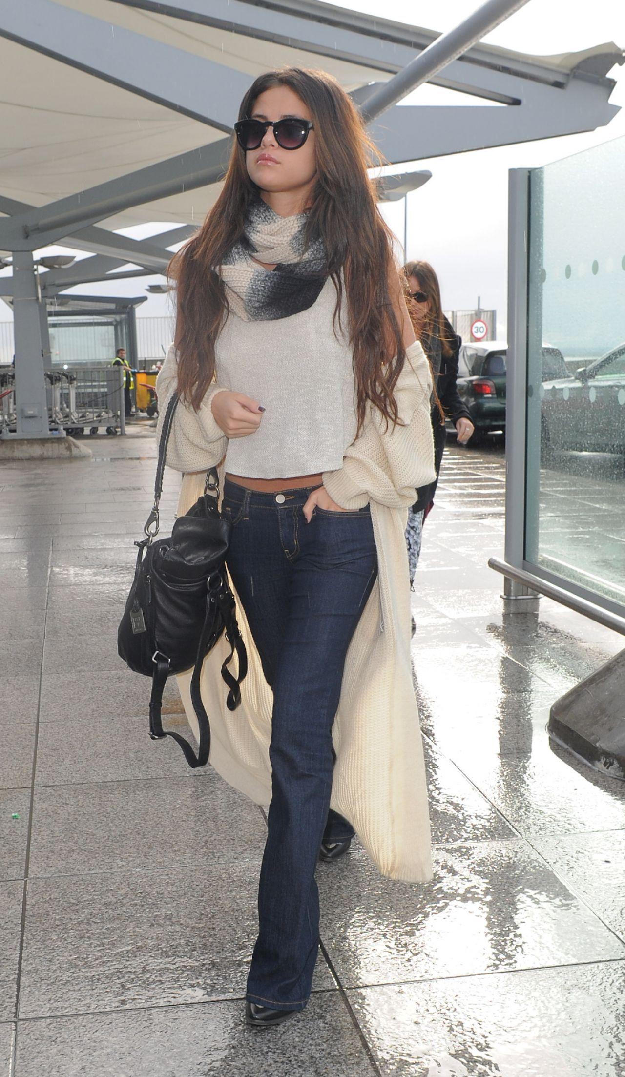 Selena Gomez Street Style - At Heathrow Airport in London, February 2014