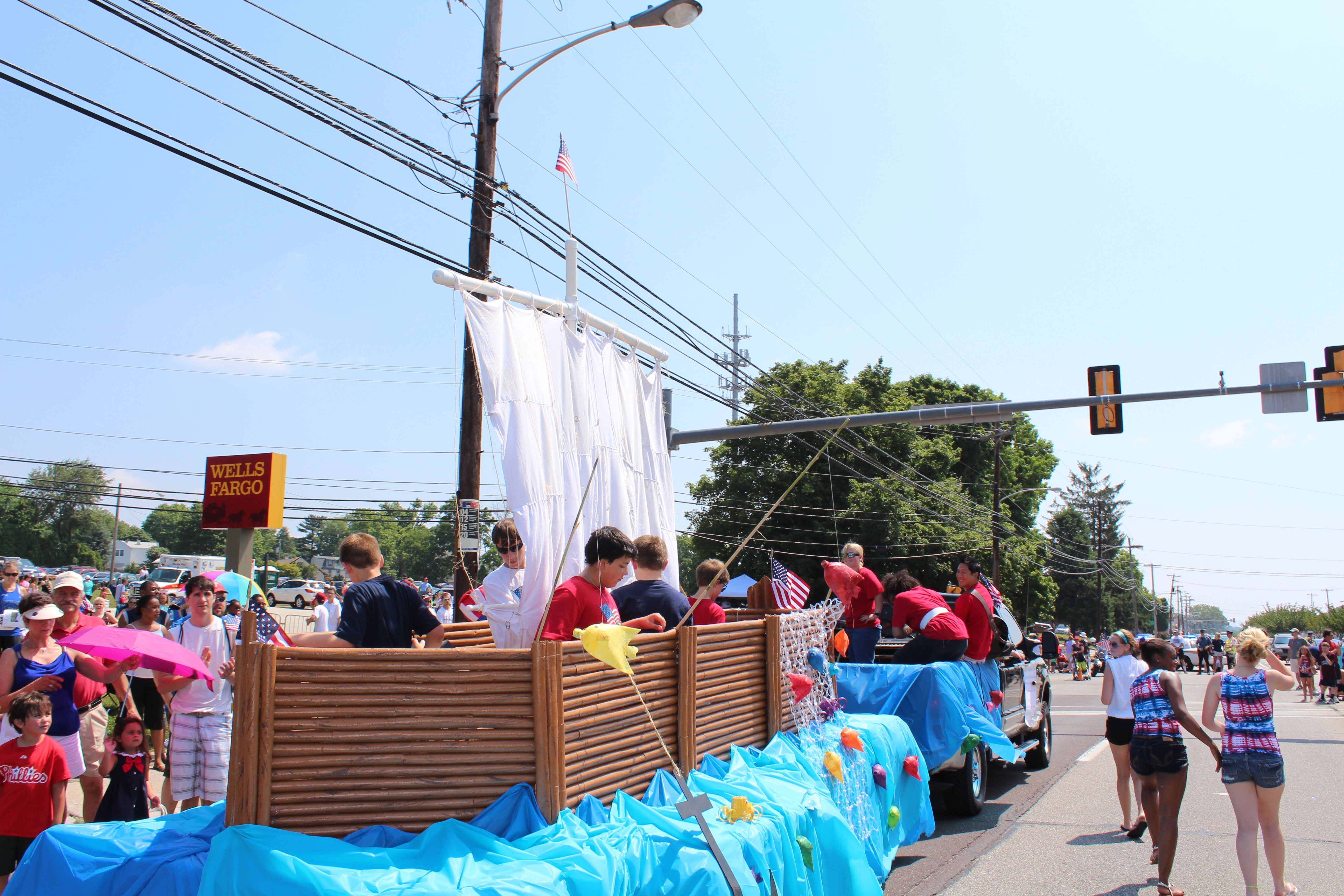Parade float is a Galilean Fishing Boat made from paper towel tubes