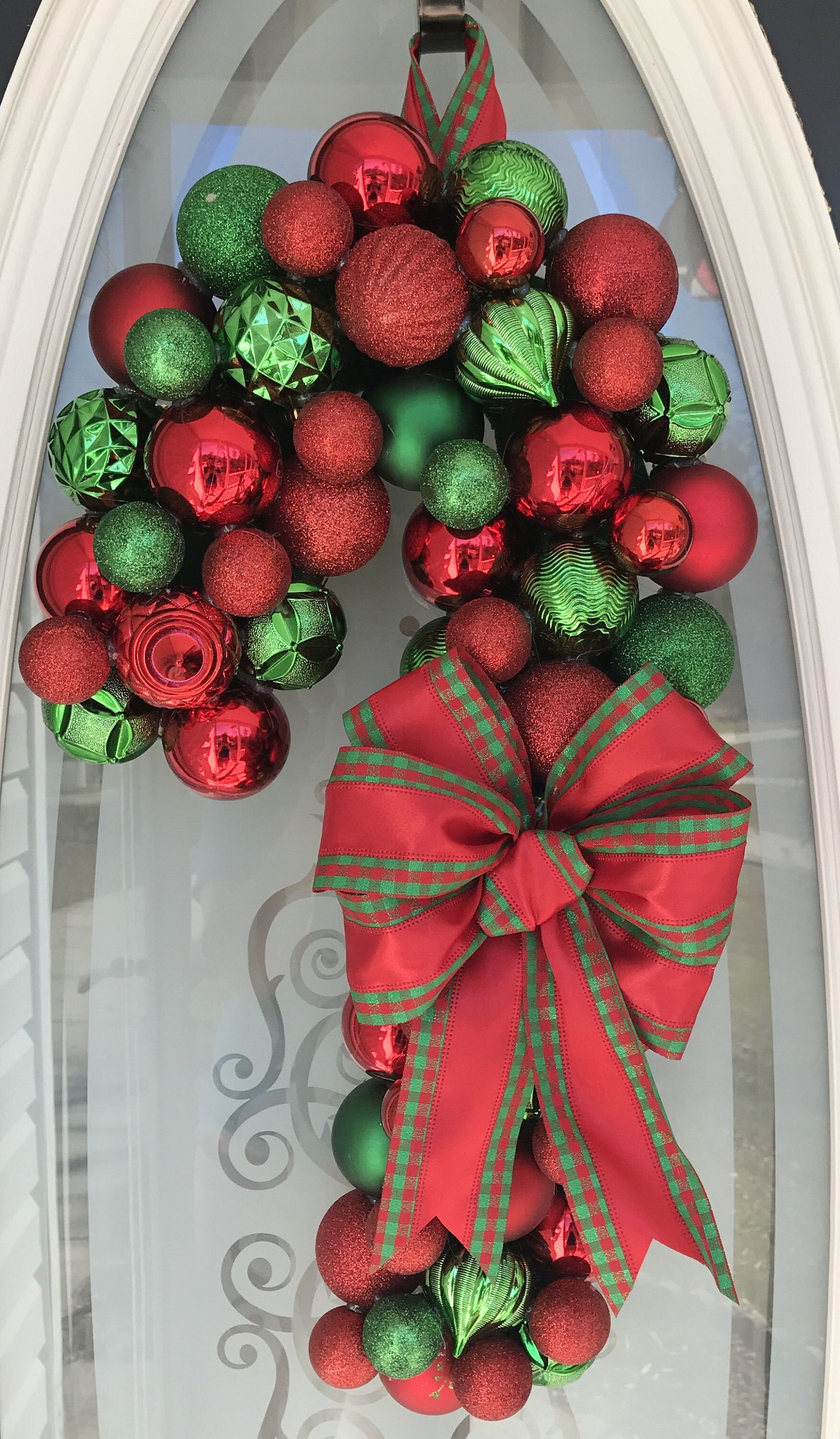 Shatterproof Ornament Candy Cane Wreath - Christmas Ornament Wreath - ready to ship - Ornament Wreath - Ball Wreath #candycanewreath This wreath is made using shatterproof ornaments. I used felt, a wire wreath form, hot glue, shatterproof (plastic) ornaments, and ribbon. It is quite durable and would make a beautiful addition to your Christmas decor! Ornament Wreaths have become one of my favorite things to make. They are clean and simple, yet elegant and unique. Each ornament is placed strategi #candycanewreath