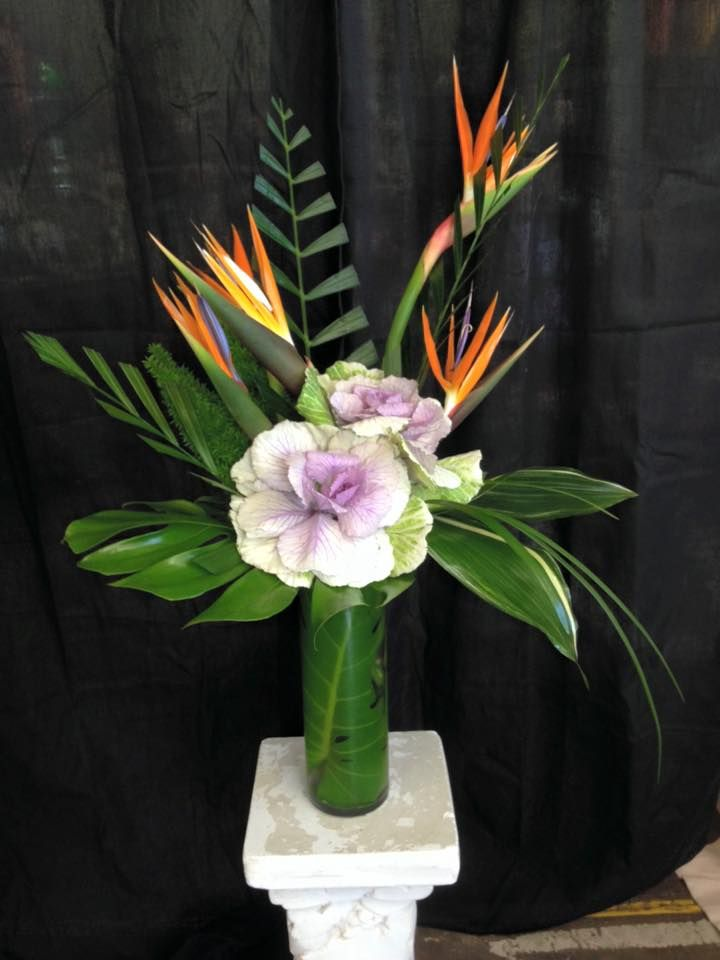 The Birds of Paradise with the pale purple floral accent are a great pop of color with this greenery arrangement.