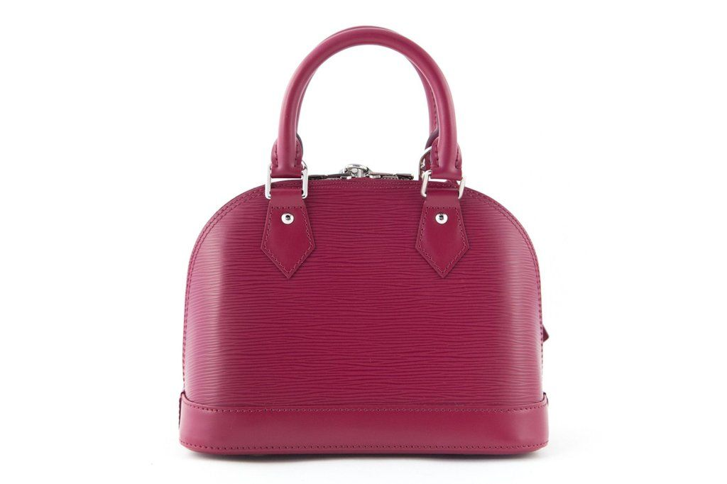 c7c5fc115f9a 100% Authentic Louis Vuitton Alma BB in fuschia Epi leather with silver  hardware. Two rolled top handles and optional shoulder strap.