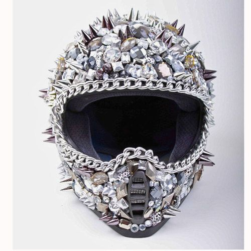 Highway To Hellmet This helmet is a must-have for livin' life in the fast lane! Rule the streets in this fully functioning motorcycle helmet. It's encrusted with giant Swarovski crystals and features hand-placed metal chains and spikes.