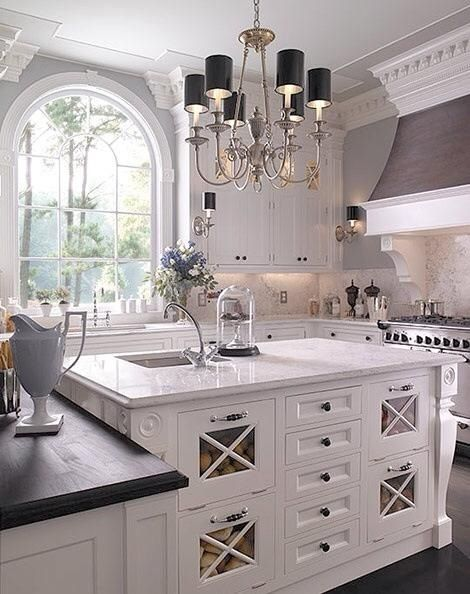 Great use of storage in this kitchen island! elegant color palette.