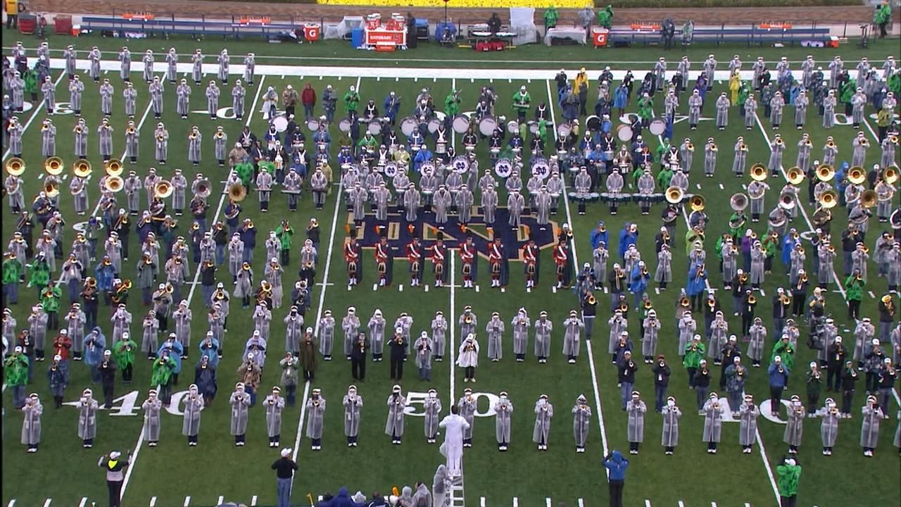 The Notre Dame Marching Band Performs Songs During Halftime Of The