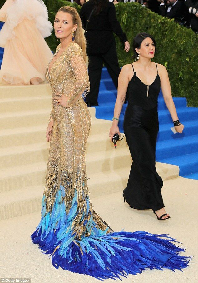 Blake Lively is a goddess in gold and feather gown at The Met Gala ...