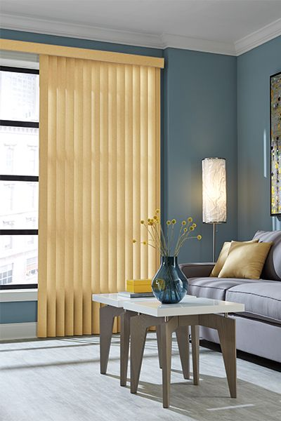 Yellow vinyl vertical blinds work well in this space against the ...