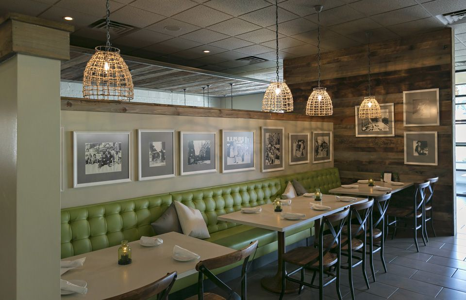 Green upholstered seating area inside Columbia SC Italian