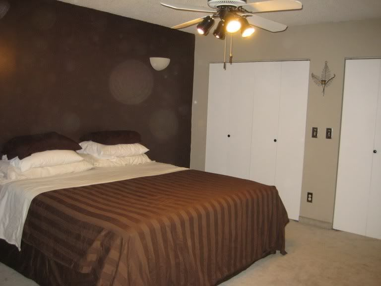 Chocolate brown bedroom brown accent wall tan walls and for Dark brown bedroom designs
