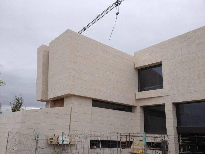 Revestimiento exterior de vivienda unifamiliar con m rmol - Piedra revestimiento exterior ...