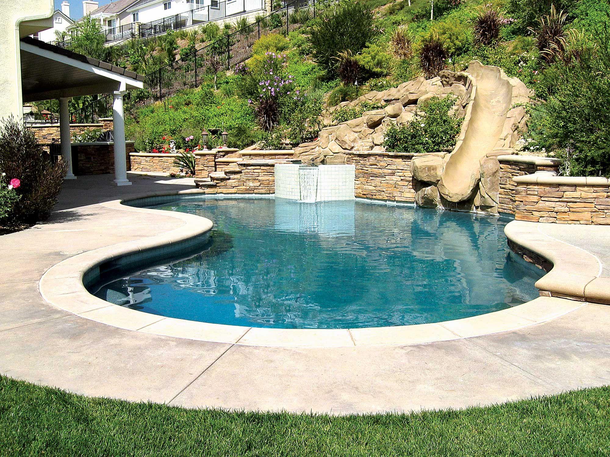 Hillside pool slide yard in 2019 lagoon pool swimming for Pool design hillside