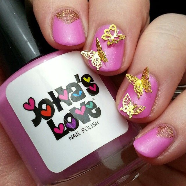 I saw a mani with these adorable gold butterflies used in this manner some time ago by @mcpolish and that mani has haunted my polish thoughts ever since. :) Base is Blushed Rose from @johaslovenailpolish, I bent the flat butterflies and also used a gold glitter striper.  #johaslovenailpolish #mcspiration