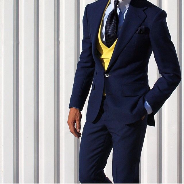 Great color combination on this suit and love the double breasted style  sweater.