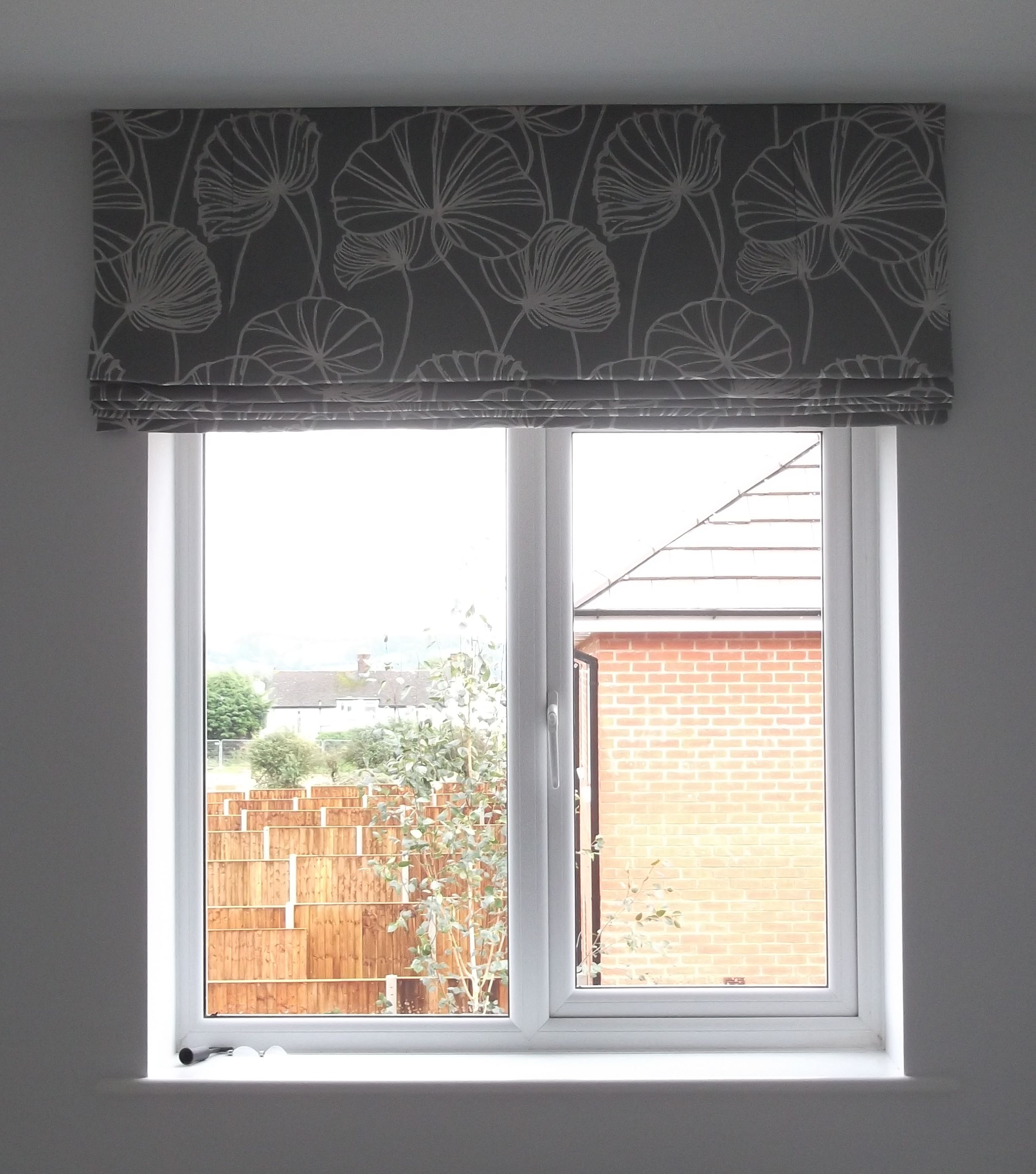 Roman blind bedroom i like it hung this high for the for Shades for bedroom windows