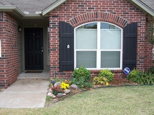 My Small House Has A Black Front Door And Two Shutters On One Of The Front Windows The Brick Has Black In Brick Exterior House Red Brick House House Shutters