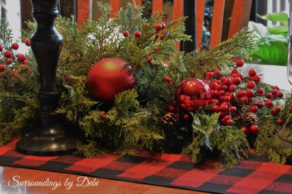 show me pictures of christmas centerpieces using a long narrow