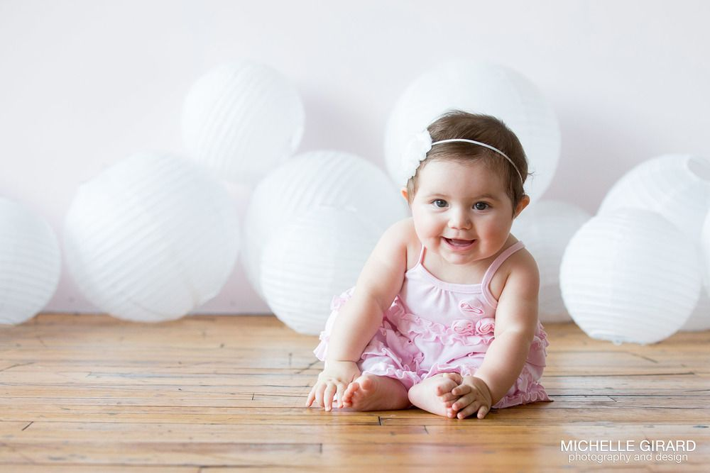 Six month old baby portraits savanna bubbles and smiles