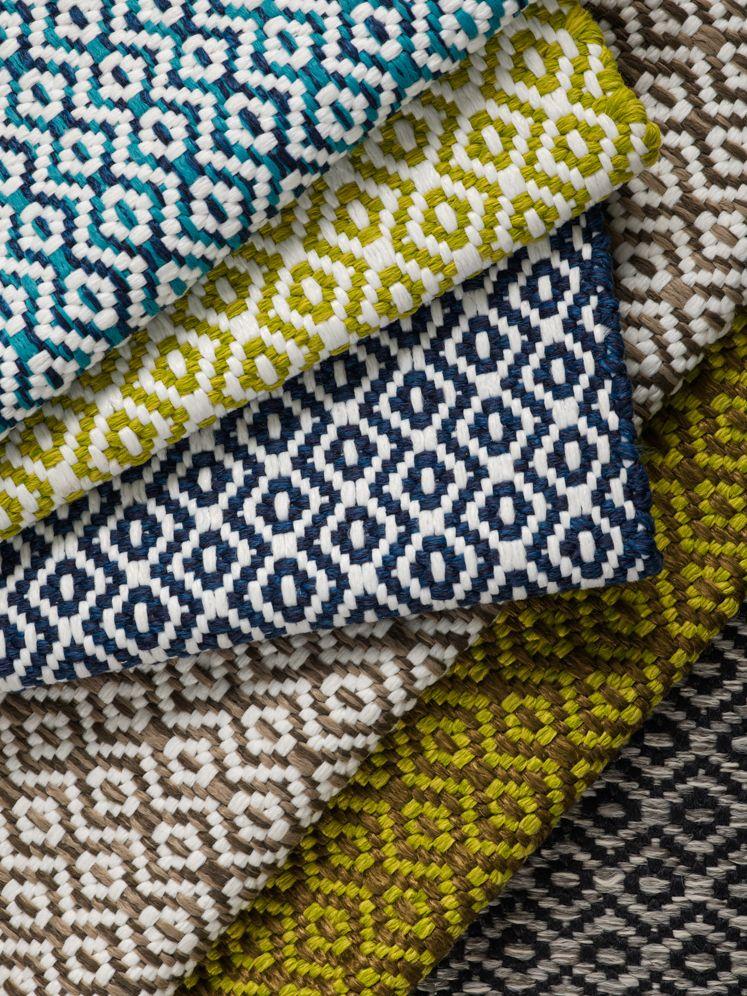 Custom flat weave outdoor rugs designed by crosby street