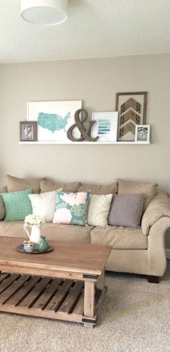 A cute ledge gallery wall Simple and sweet! Dream House Room - Simple Living Room Designs