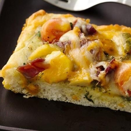 Mediterranean Breakfast Pizza made super easy with microwaved veggies, kale, prosciutto, and pesto?! Yes, please!