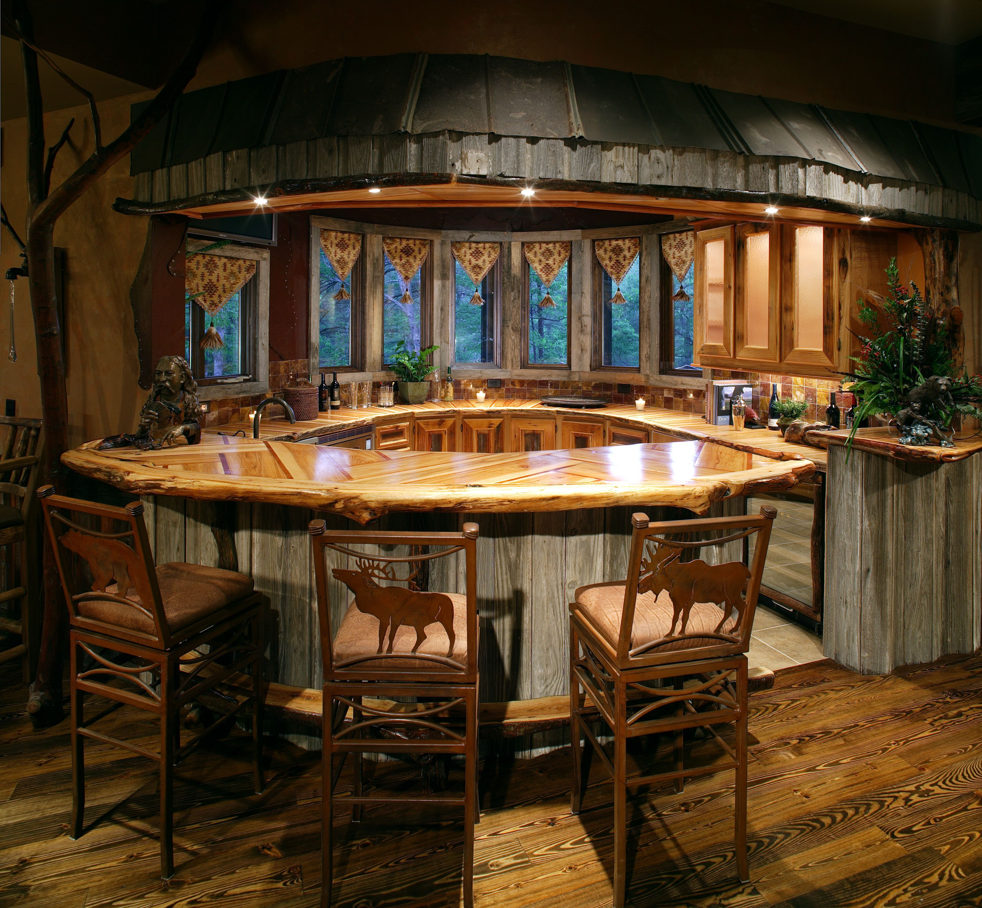 Rustic kitchen that is made for entertaining with the curved bar ...