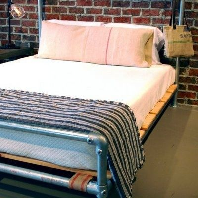 pipe bed against red brick wall - Diy Pipe Bed Frame