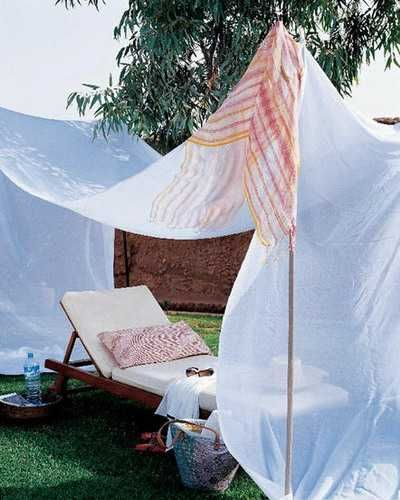 handmade white sunshade above lounge chair