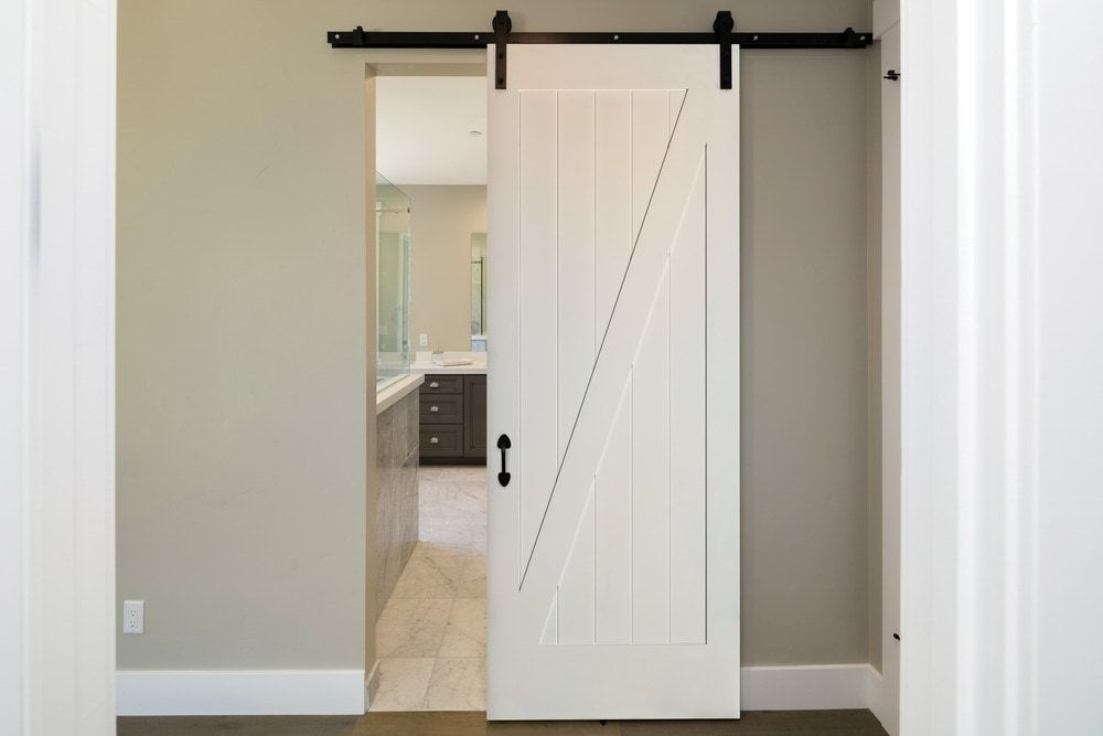 Builddirect American Door Company 48 X 84 Primed 1 Panel Z Bar Barn Door With Black Hardware Interior Barn Door Hardware Barn Door Interior Barn Doors